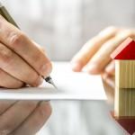 man-signing-rental-bond-agreement